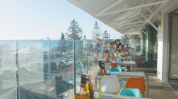 New bar patrons drink in ocean views