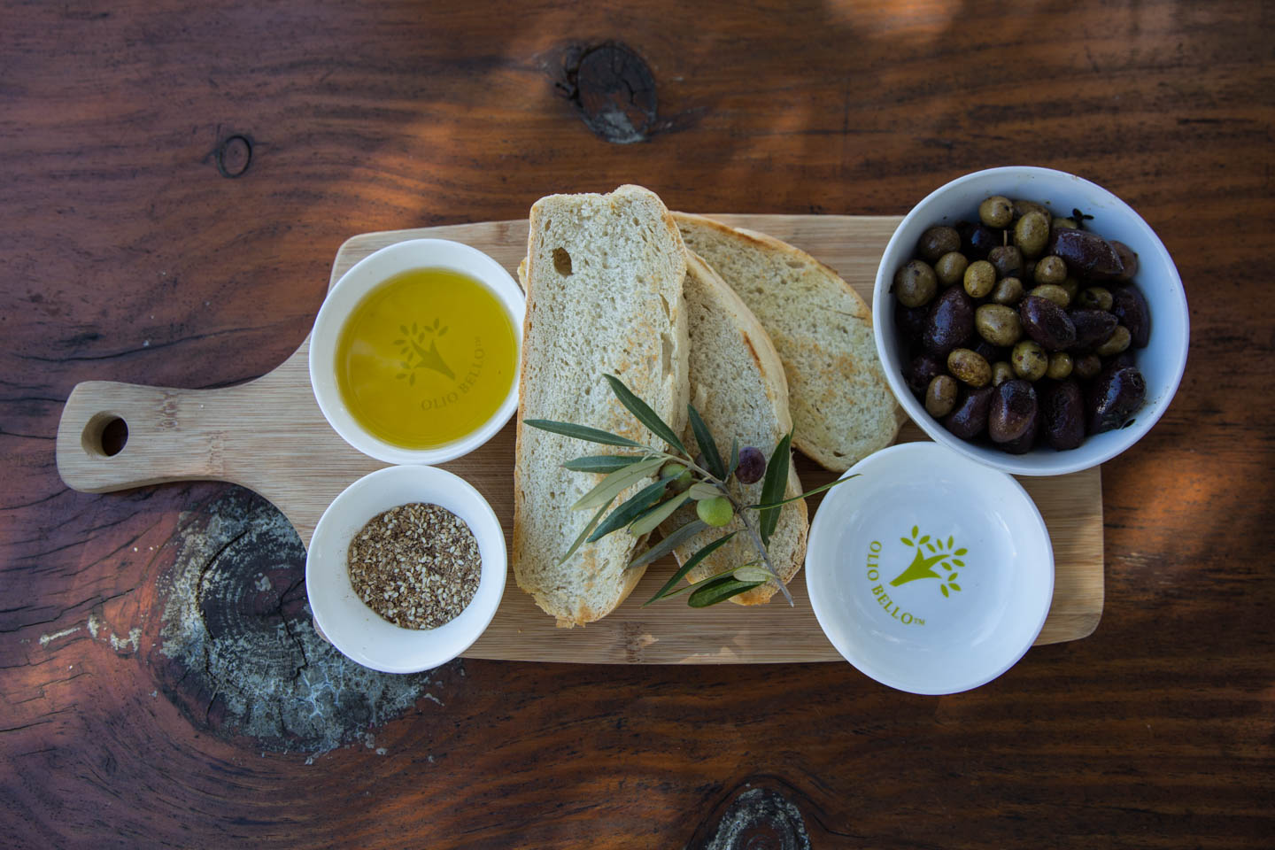 Premium olive oil with warmed olives and house baked bread