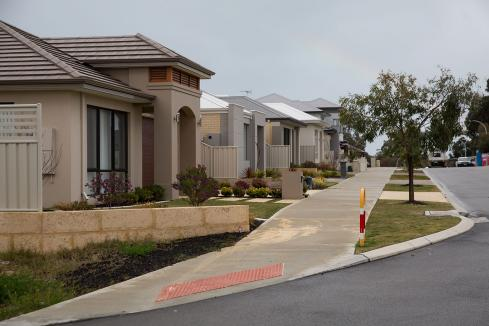 RBA cuts rate to record low amid house price slump