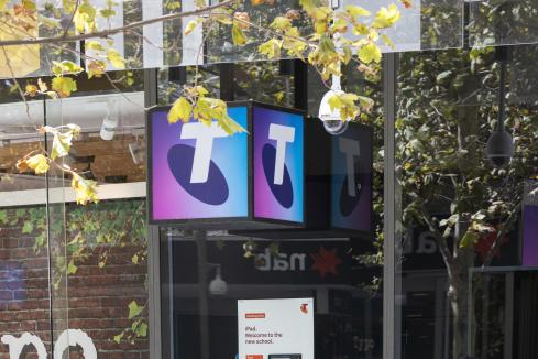 Telstra first-half profit dips on NBN, fires