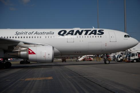 Qantas slashes overseas flights