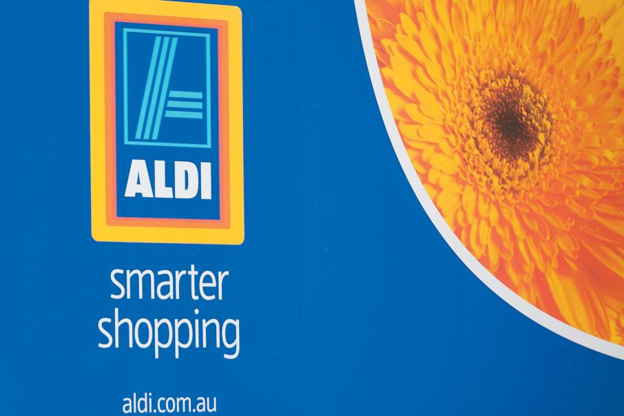 Supermarket giants squeezed from both sides