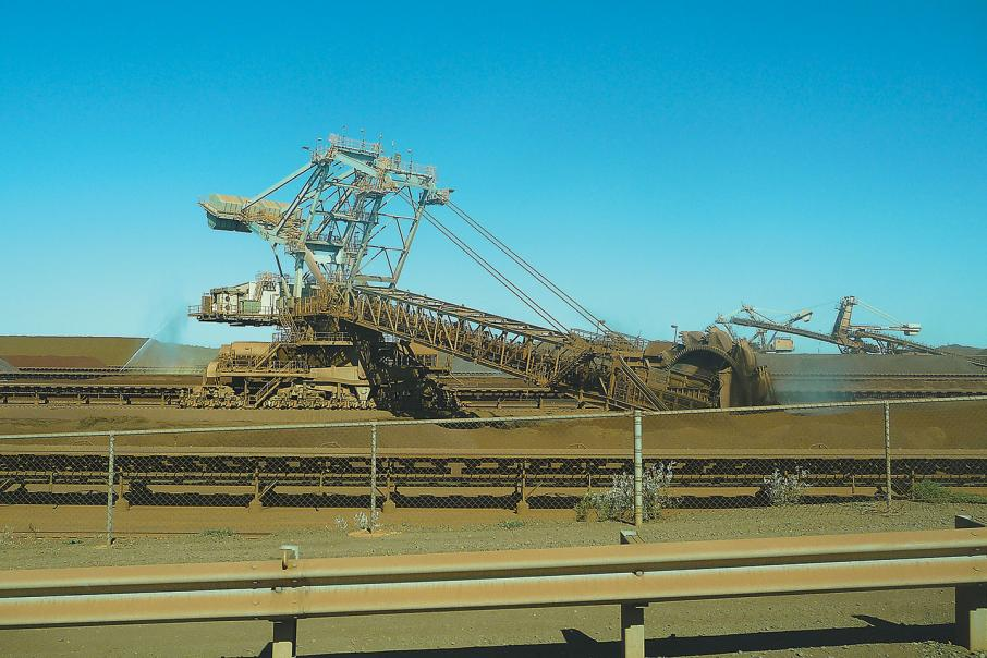 Price slump hits iron ore revenue