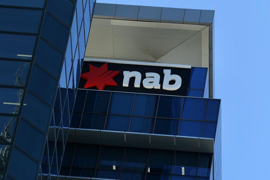 NAB flags advice sale as H1 profit falls