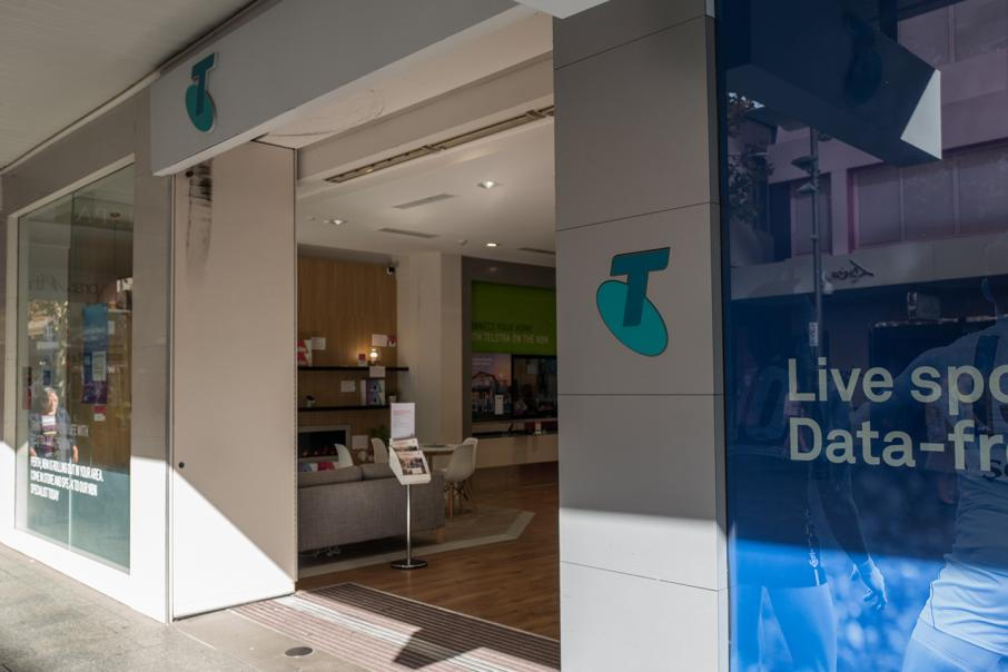 Telstra at three-month high despite profit drop