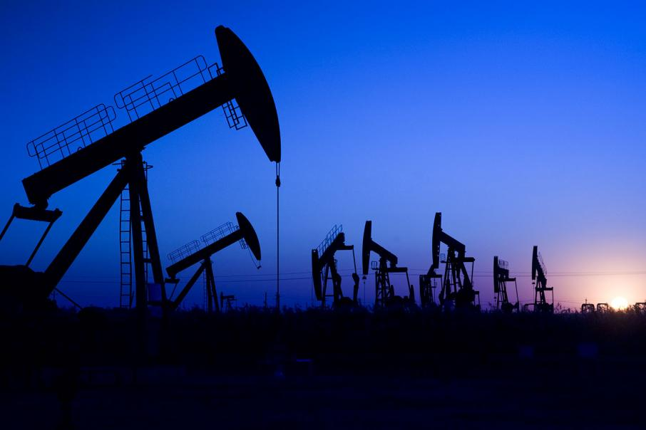 Oil prices down on supply jump, trade war