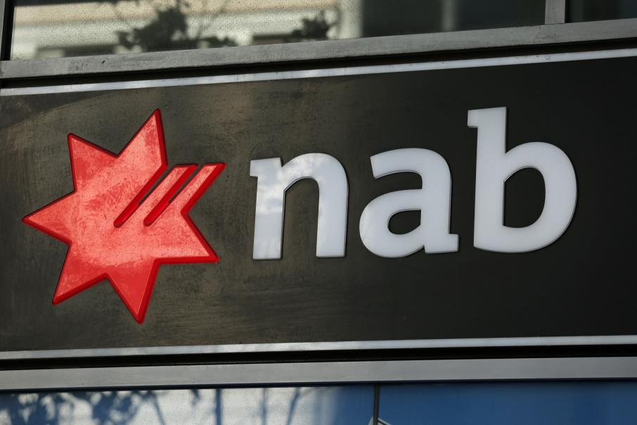 NAB cuts dividend to lowest in nearly nine years